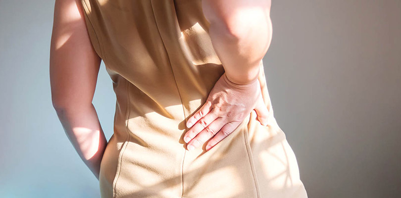 Woman is experiencing lower back pain